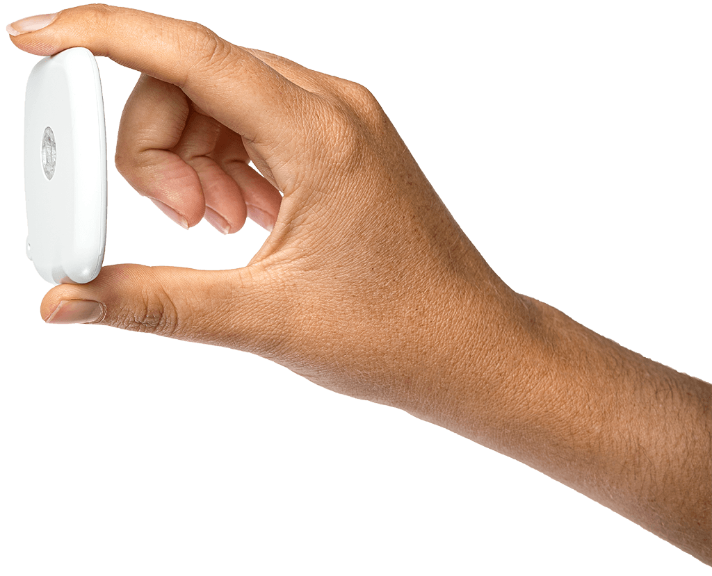 Qlibrium slim, wearable pump OBDS being held by a hand